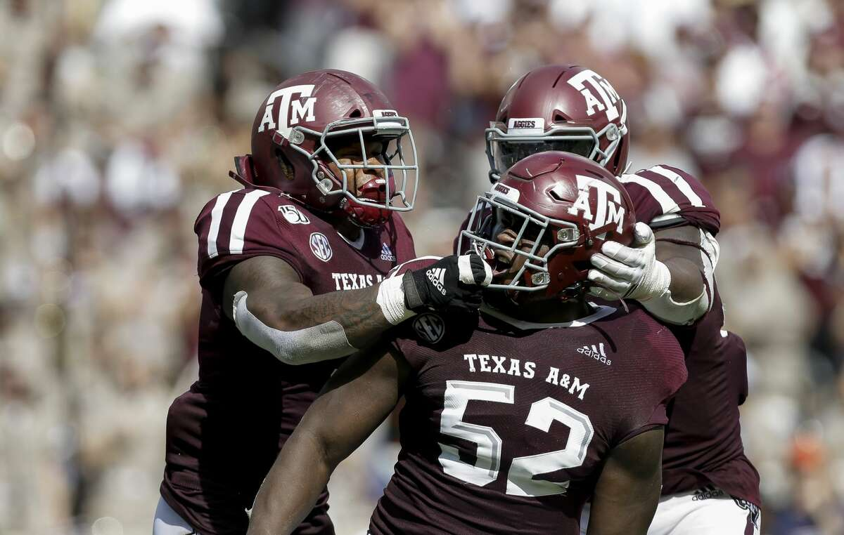 Texas A&M Aggies defensive lineman Justin Madubuike (52) celebrates with teammates after sacking Auburn Tigers quarterback Bo Nix (10) during the second quarter of an SEC game at Kyle Field Saturday, Sept. 21, 2019, in College Station, TX. The Tigers won 28-20.