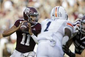 Texas A&M Aggies quarterback Kellen Mond (11) looks for an open receiver against the Auburn Tigers during the third quarter of an SEC game at Kyle Field Saturday, Sept. 21, 2019, in College Station, TX. The Tigers won 28-20.