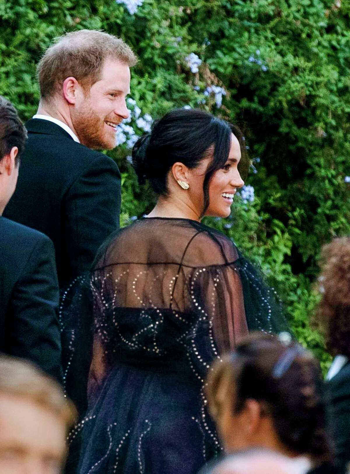 Britain's Prince Harry and his wife Meghan, Duchess of Sussex arrive to the wedding of Misha Nonoo and Michael Hess in Rome, Friday, Sept. 20, 2019. Britain's Prince Harry and his wife Meghan, Duchess of Sussex will attend the wedding of their friends before leaving on an official trip to Africa. (Claudio Peri/ANSA via AP)