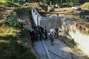 A construction worker fell eight feet and hit his head while working on a building foundation Saturday morning, Sept. 21, 2019, in Norwalk, Conn.