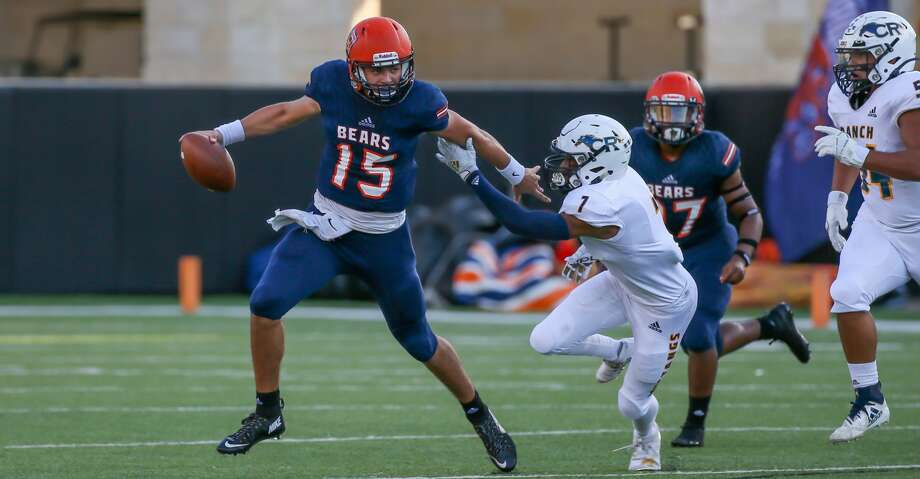 Bridgeland quarterback Conner Weigman (15) evades a tackle by Cypress Ranch defensive back Robin Neely (7) in the first quarter of a high school football game, Saturday, Sept. 21, 2019 in Cypress, TX. Photo: Leslie Plaza Johnson/Contributor