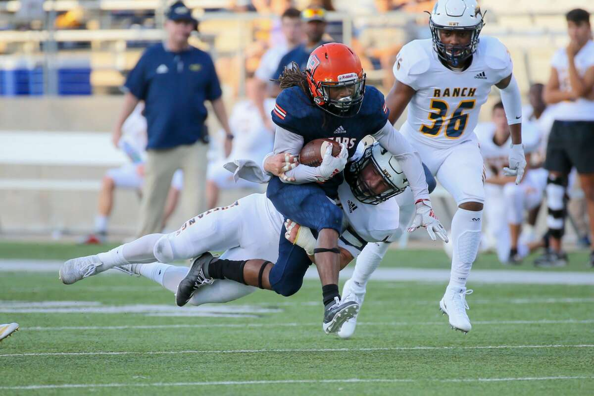 Cypress Ranch linebacker Landen Nowak (45) tackles Bridgeland wide receiver Atrevion Hunter (7) in the second quarter of a high school football game, Saturday, Sept. 21, 2019 in Cypress, TX.