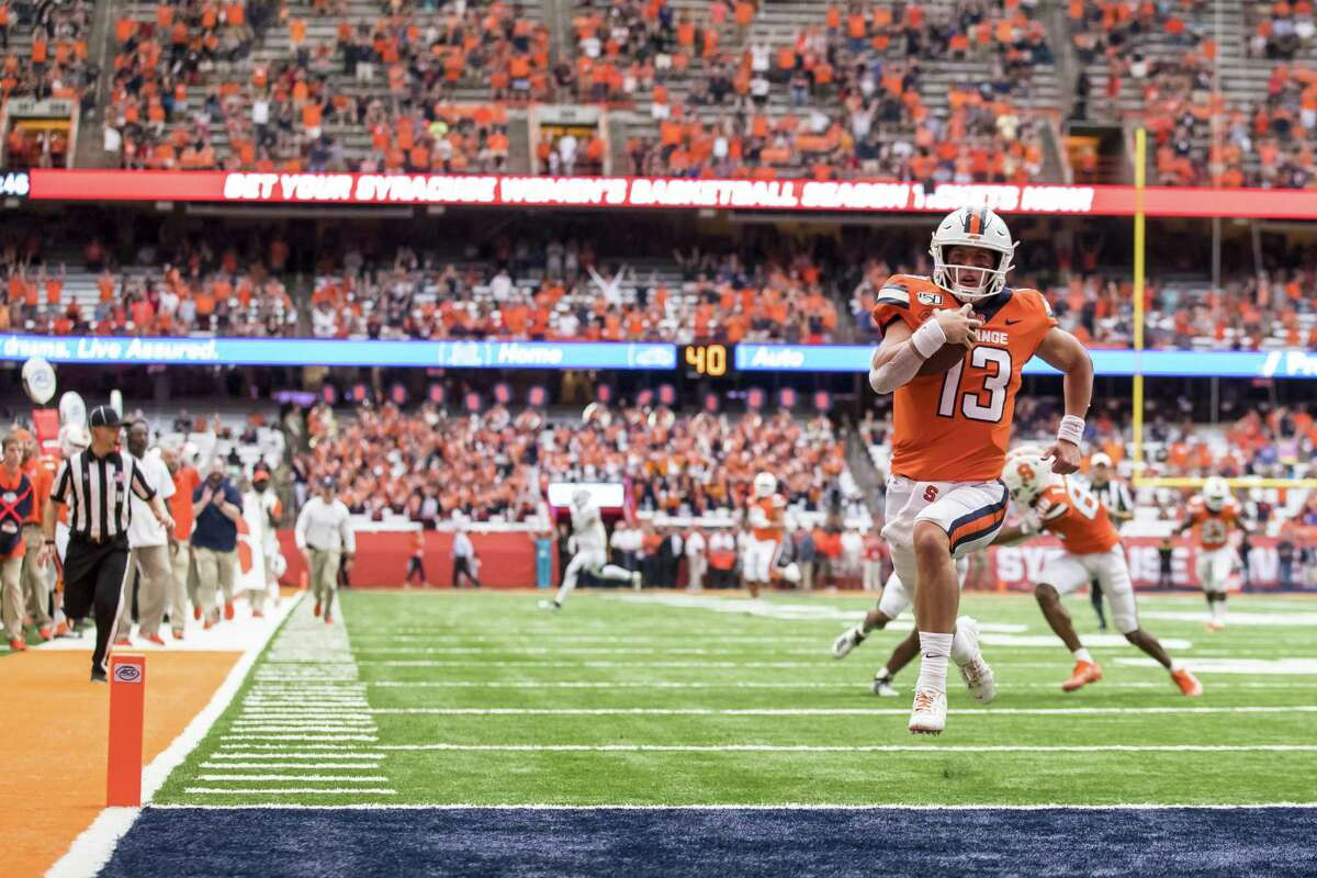 SYRACUSE, NY - SEPTEMBER 21: Tommy DeVito #13 of the Syracuse Orange carries the ball for a touchdown during the second quarter against the Western Michigan Broncos at the Carrier Dome on September 21, 2019 in Syracuse, New York. (Photo by Brett Carlsen/Getty Images)
