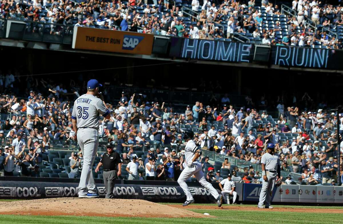 NEW YORK, NEW YORK - SEPTEMBER 21: Brock Stewart #35 of the Toronto Blue Jays looks on from the mound as Giancarlo Stanton #27 of the New York Yankees runs the bases after his sixth inning home run at Yankee Stadium on September 21, 2019 in the Bronx borough of New York City. (Photo by Jim McIsaac/Getty Images)