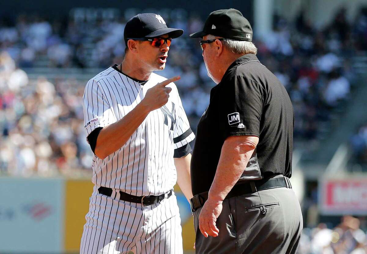 NEW YORK, NEW YORK - SEPTEMBER 21: Manager Aaron Boone #17 of the New York Yankees argues with umpire crew chief Joe West after he was ejected from a game against the Toronto Blue Jays between the first and second innings at Yankee Stadium on September 21, 2019 in the Bronx borough of New York City. (Photo by Jim McIsaac/Getty Images)