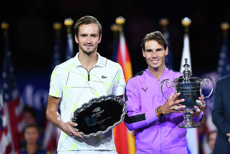TOPSHOT - Rafael Nadal of Spain (R) holds the trophy after his win over Daniil Medvedev of Russia (L) during the men's Singles Finals match at the 2019 US Open at the USTA Billie Jean King National Tennis Center in New York on September 8, 2019. - Rafael Nadal captured his 19th career Grand Slam title in thrilling fashion on Sunday by winning the US Open final, outlasting Russia's Daniil Medvedev 7-5, 6-3, 5-7, 4-6, 6-4 to seize his fourth crown in New York. (Photo by Johannes EISELE / AFP)JOHANNES EISELE/AFP/Getty Images Photo: JOHANNES EISELE / AFP or licensors