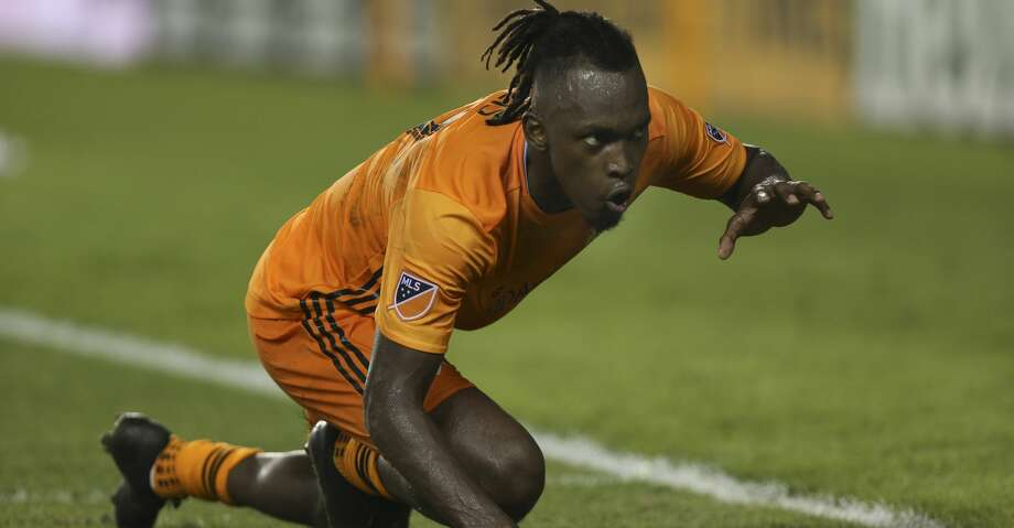Houston Dynamo forward Alberth Elis (17) does his signature panther crawl to celebrate his second goal of the game against the New York Red Bulls during the second half of the MLS game at BBVA Stadium on Wednesday, July 3, 2019, in Houston. Photo: Yi-Chin Lee/Staff Photographer