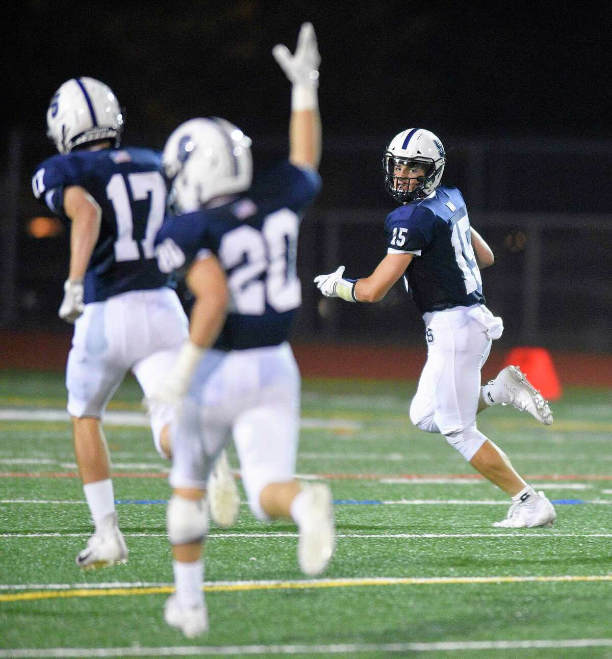 Staple's Jake Thaw returns a punt for a 69 yard touchdown against New Britain in a non-conference football game at Norwalk High School's Testa Field in Norwalk, Conn. on Sept. 21, 2019. Staples won 14-8.