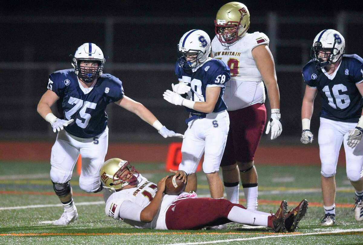 Staples Andrew Goldberg (75) sacks New Britain quarterback Monte Dickson for a loss during a non-conference football game at Norwalk High School's Testa Field in Norwalk, Conn. on Sept. 21, 2019. Staples won 14-8.