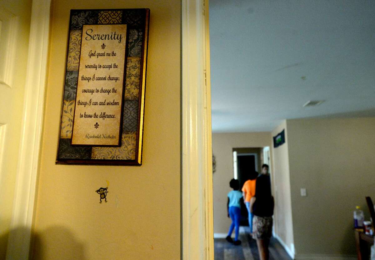A serenity prayer sign hangs on the wall at the Sanchez home on Avenue H as the process of recovery from Imelda's torrential rains and flooding begins throughout the region Friday. Photo taken Friday, September 20, 2019 Kim Brent/The Enterprise