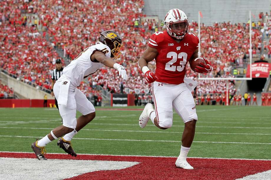 MADISON, WISCONSIN - SEPTEMBER 07: Jonathan Taylor #23 of the Wisconsin Badgers scores a touchdown past Norman Anderson #16 of the Central Michigan Chippewas in the first quarter at Camp Randall Stadium on September 07, 2019 in Madison, Wisconsin. (Photo by Dylan Buell/Getty Images) Photo: Dylan Buell / Getty Images