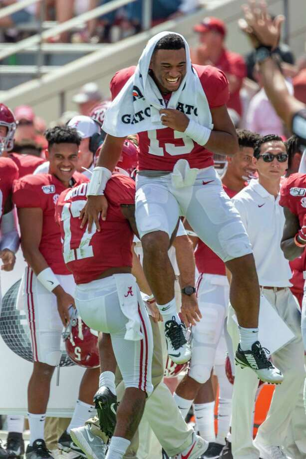 Alabama quarterback Tua Tagovailoa (13) leaps into the air to celebrate a 41-yard punt return by Alabama wide receiver Jaylen Waddle (17) during the second half of an NCAA college football game against Southern Miss, Saturday, Sept. 21, 2019, in Tuscaloosa, Ala. (AP Photo/Vasha Hunt) Photo: Vasha Hunt / Copyright 2019, The Associated Press. All rights reserved.