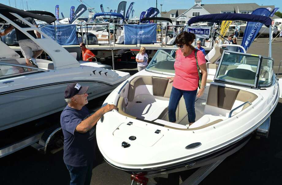 Norwalk residents Morrie and Maribeth Marino check out the Chapparel 21 SSI during the 2019 Progressive Insurance Norwalk Boat Show Saturday, September 21, 2019, at Cove Marina in Norwalk, Conn. The show features a full selection of watercrafts for every budget and lifestyle. Attendees to the show can boat hop and shop magnificent motor yachts, tricked-out runabouts, serious center consoles and watersports boats galore. Plus, upgrade boating technology and water toys with thousands of the latest and greatest GPS and radar systems, fishing equipment, design finishes, all-weather apparel, watersports gear and more from top outfitters and brands. Photo: Erik Trautmann / Hearst Connecticut Media / Norwalk Hour