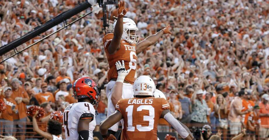 AUSTIN, TX - SEPTEMBER 21:  Devin Duvernay #6 of the Texas Longhorns celebrates with teammates after a touchdown reception in the second quarter against the Oklahoma State Cowboys at Darrell K Royal-Texas Memorial Stadium on September 21, 2019 in Austin, Texas.  (Photo by Tim Warner/Getty Images) Photo: Tim Warner/Getty Images
