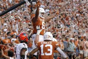AUSTIN, TX - SEPTEMBER 21:  Devin Duvernay #6 of the Texas Longhorns celebrates with teammates after a touchdown reception in the second quarter against the Oklahoma State Cowboys at Darrell K Royal-Texas Memorial Stadium on September 21, 2019 in Austin, Texas.  (Photo by Tim Warner/Getty Images)