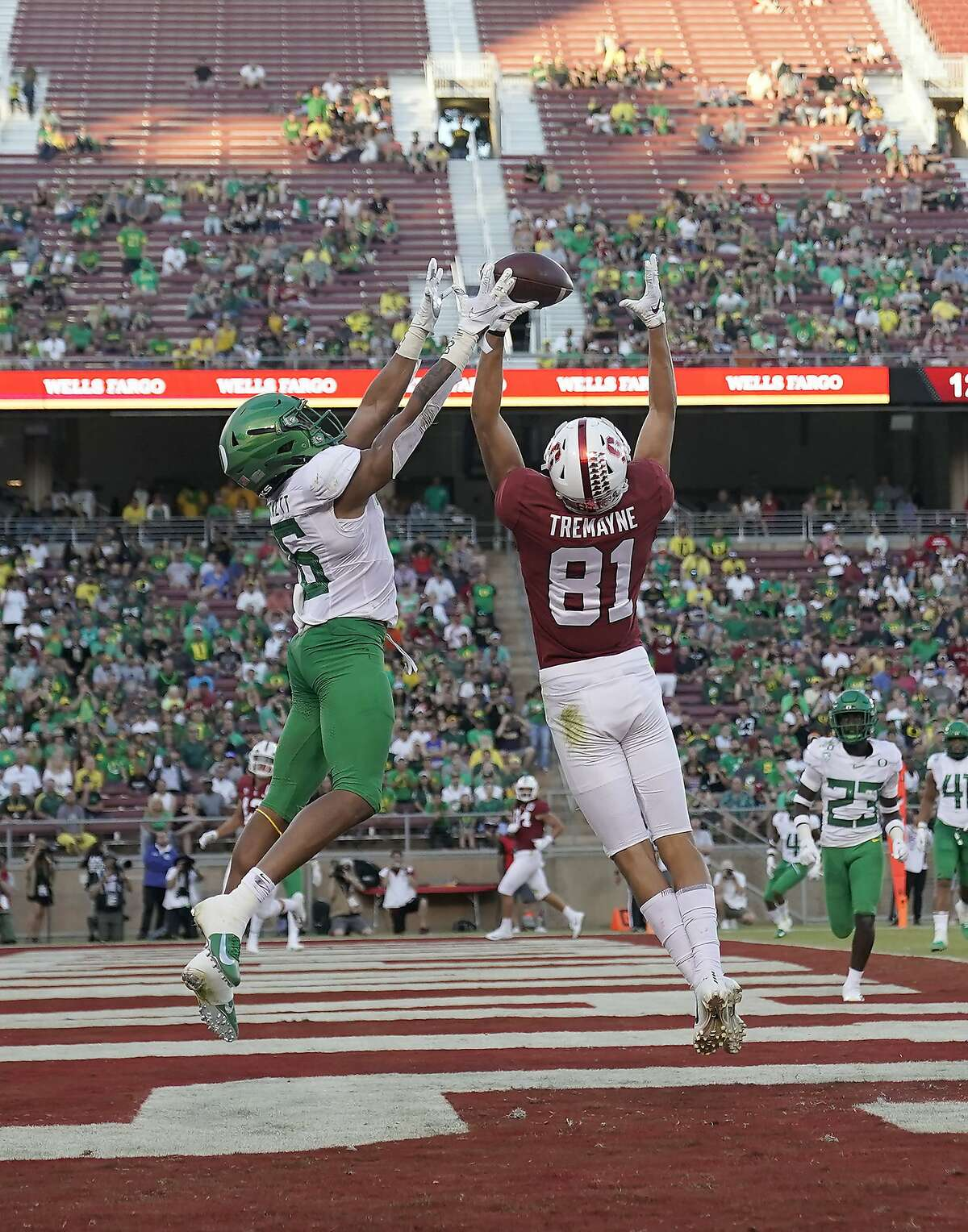 Oregon cornerback Deommodore Lenoir (6) breaks up a pass in the end zone for Stanford wide receiver Brycen Tremayne (81) during the second half of an NCAA college football game Saturday, Sept. 21, 2019, in Stanford, Calif. (AP Photo/Tony Avelar)
