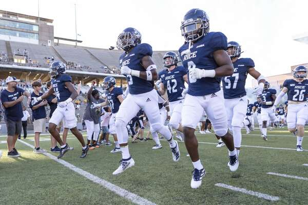 Rice running back Cameron Montgomery (8) runs onto the field before a college football game against Baylor Saturday, Sep 21, 2019, in Houston.