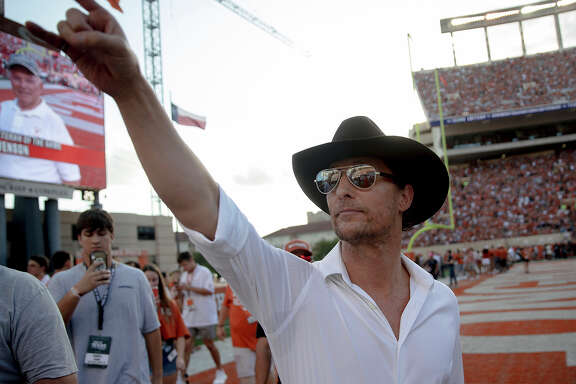 "Actor Matthew McConaughey holds up the ""Hook 'Em Horns"" sign to Texas fans before an NCAA college football game against Oklahoma State, Saturday, Sept. 21, 2019, in Austin, Texas. (Nick Wagner/Austin American-Statesman via AP)"