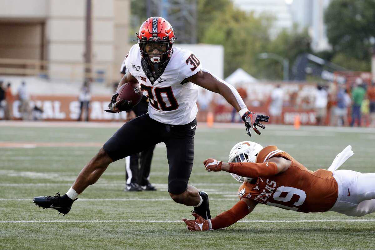PHOTOS: The reaction from Oklahoma State football players to coach Mike Gundy's shirt Oklahoma State running back Chuba Hubbard led the nation in rushing with 2,094 yards last season as a sophomore.