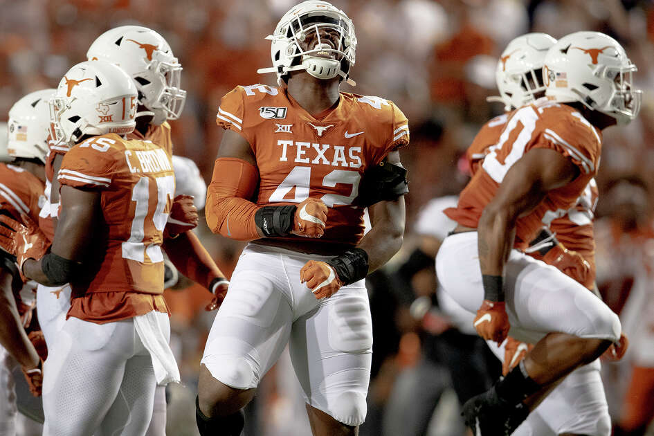 Texas defensive lineman Marqez Bimage (42) celebrates a stop against Oklahoma State during an NCAA college football game Saturday, Sept. 21, 2019, in Austin, Texas. (Nick Wagner/Austin American-Statesman via AP)