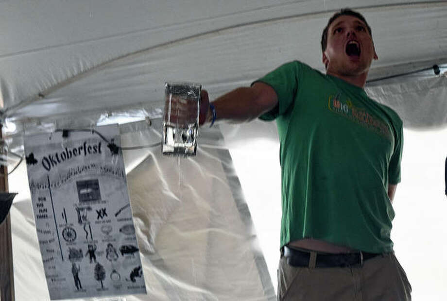 Stein endurance challenge winner Kevin Danaher of Edwardsville tries to hold back the pain during Oktoberfest on Saturday.