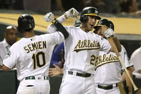 A's bash Rangers 12-3, take another big step toward playoffs
