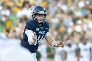 Rice quarterback Tom Stewart (14) puts the receiver in motion during the first half of a college football game Saturday, Sep 21, 2019, in Houston.