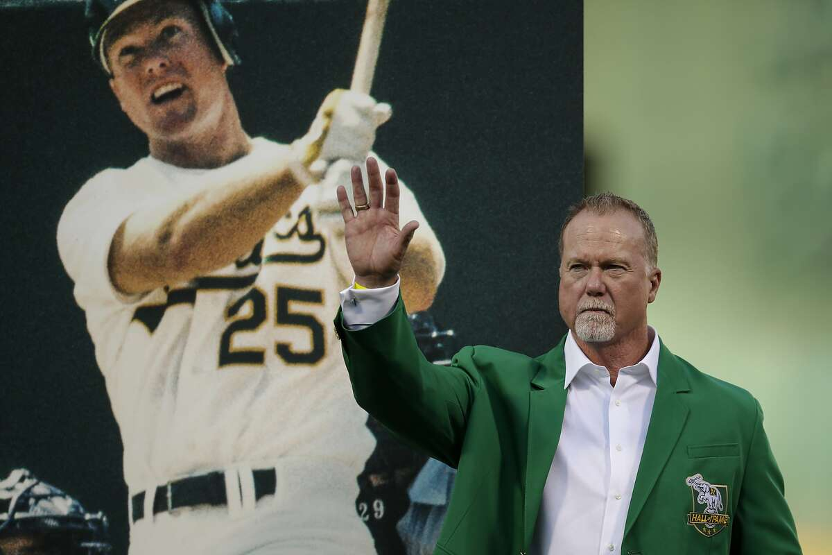 Former Oakland Athletics Mark McGwire waves to fans after being inducted into the A's Hall of Fame prior to the baseball game against the Texas Rangers Saturday, Sept. 21, 2019, in Oakland, Calif. (AP Photo/Ben Margot)