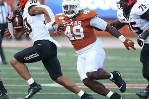 Texas defensive end Ta'Quon Graham, pursuing Oklahoma State's Chuba Hubbard last year, said new defensive coordinator Chris Ash's system will help him have a good senior season.