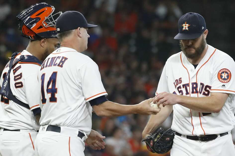 Houston Astros manager AJ Hinch (14) pulls starting pitcher Wade Miley (20) after 27 pitches in the second inning of an MLB baseball game at Minute Maid Park, Saturday, Sept. 21, 2019, in Houston.