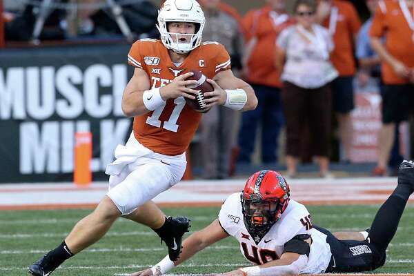 Texas quarterback Sam Ehlinger finds room to run against Oklahoma State on Saturday night.