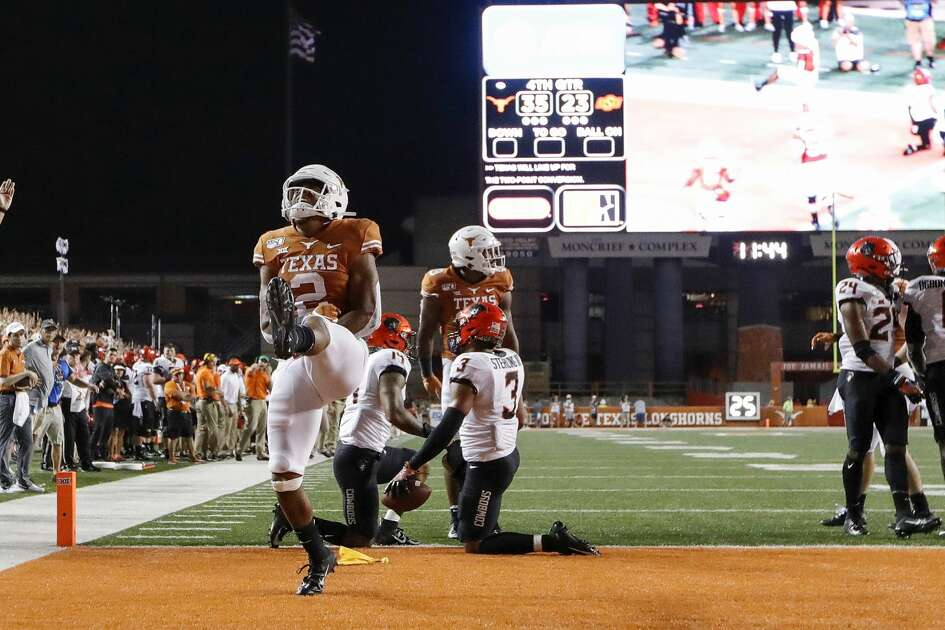 AUSTIN, TX - SEPTEMBER 21: Roschon Johnson #2 of the Texas Longhorns celebrates after scoring a two point conversion in the fouth quarter against the Oklahoma State Cowboys at Darrell K Royal-Texas Memorial Stadium on September 21, 2019 in Austin, Texas. (Photo by Tim Warner/Getty Images)