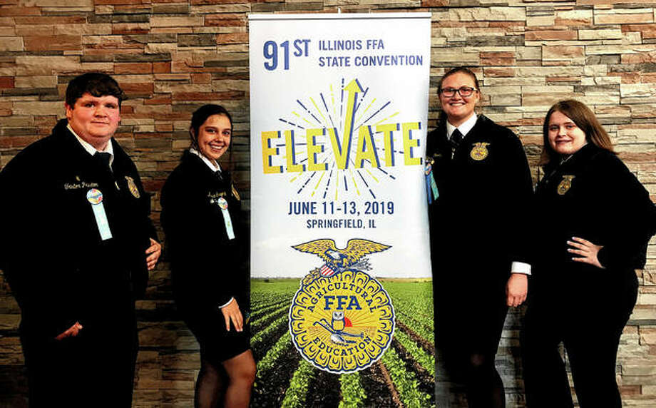 Bluffs FFA chapter members spent part of their summer attending the 91st Illinois FFA State Convention in Springfield. While attending the convention, participants were on hand for awards sessions, the election of the new state officers team and a visit to the Dana Thomas House. Those attending included Triston Preston (from left), Kaydence Gregory, Morgan Hoots and Madison Hopkins. Photo: Photo Provided