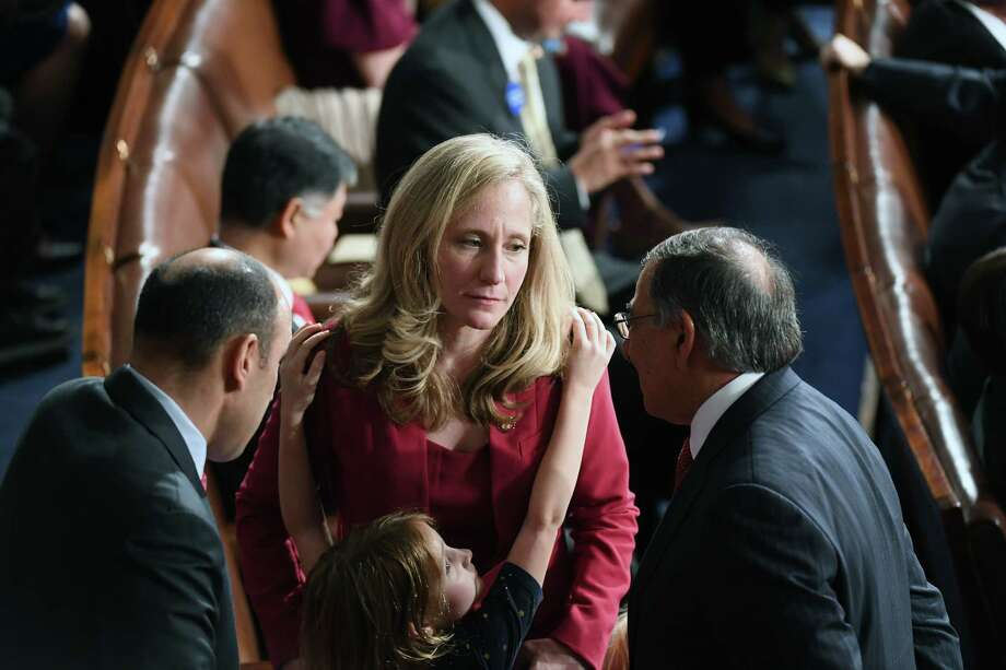 Rep. Abigail Spanberger, D-Va., talks on the House floor with Leon Panetta, right, in January in Washington, D.C. Spanberger joined fellow Democrats over the August recess and last week in Washington to urge Senate Majority Leader Mitch McConnell, R-Ky., to hold floor votes on House-passed legislation. Photo: Washington Post Photo By Matt McClain / The Washington Post