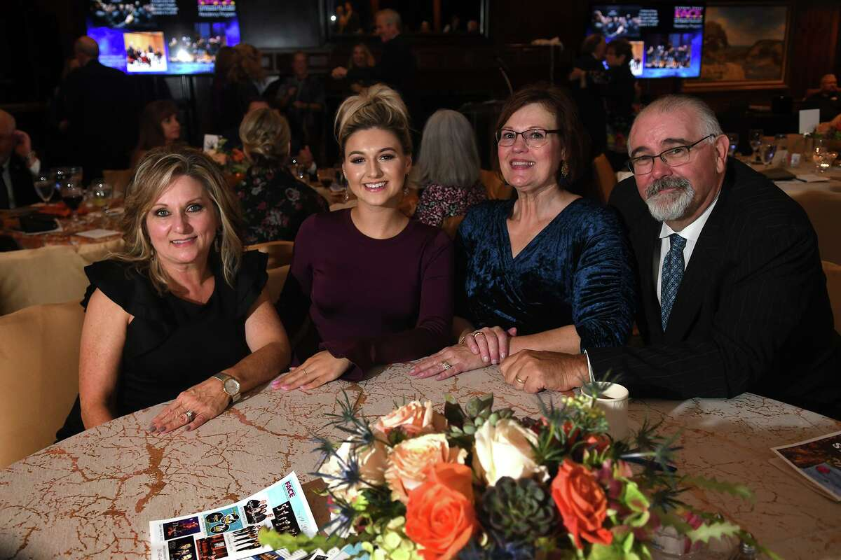 Cheryl Guenther, from left, her daughter Lauren Lothringer, Janet Cagle, and and her husband Jack share a photo during the Centrum Arts League Annual Best of the Nothwest Gala