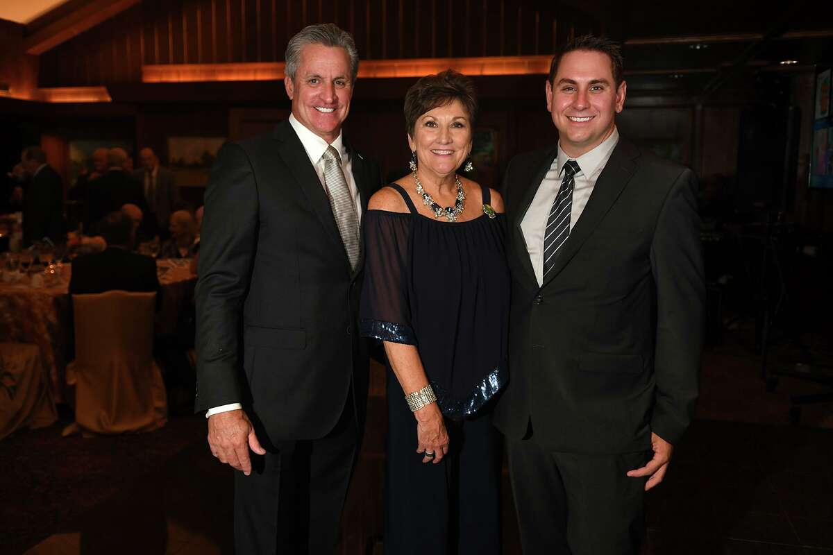 State Rep. Sam Harless, left, and his son Justin, right, share a photo with Sue Stewart at the Centrum Arts League Annual Best of the Nothwest Gala