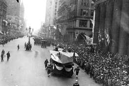 A Naval Aircraft Factory float with hull of a patrol seaplane in Philadelphia's Fourth Liberty Loan parade on Sept. 28, 1918. Today, historians blame the packed event for the spread of the devastating influenza epidemic in the city.