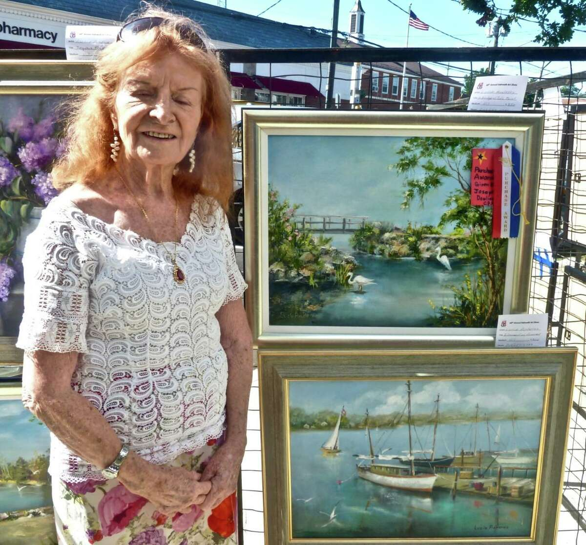 """Lucie Anderes won the J.M. Dowling CPA Award for her oil painting of """"A Bridge at Tod's Point."""""""