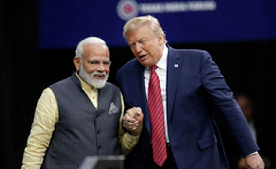 """Prime Minister Narendra Modi and President Donald Trump shake hands after introductions during the """"Howdi Modi"""" event Sunday, Sept. 22, 2019, at NRG Stadium in Houston. (AP Photo/Michael Wyke) Photo: Michael Wyke, Associated Press / Copyright 2019 The Associated Press. All rights reserved."""