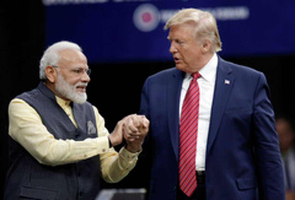 Prime Minister Narendra Modi and President Donald Trump shake hands after introductions during the