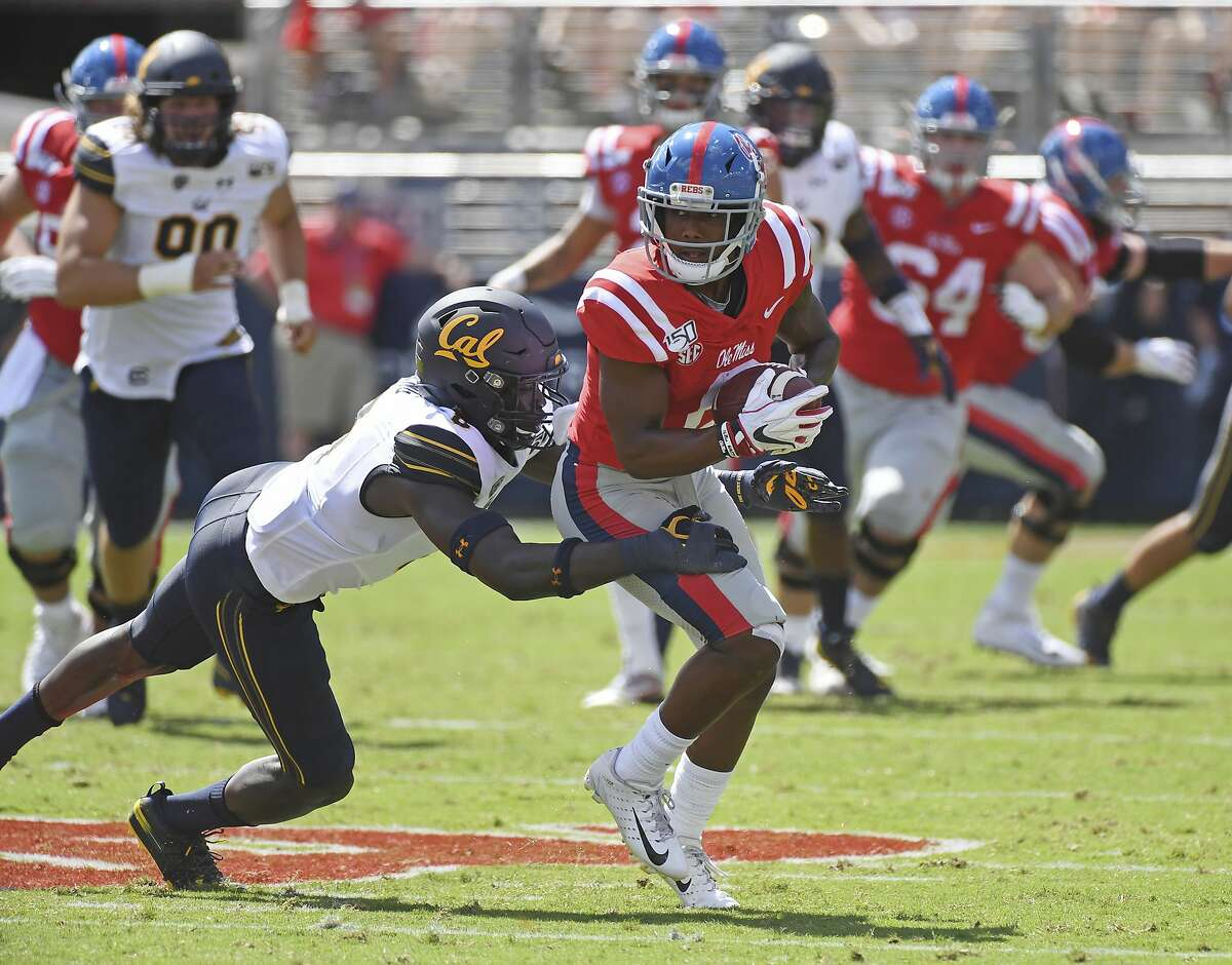 California linebacker Kuony Deng (8) tackles Mississippi wide receiver Elijah Moore (8) during the first half of an NCAA college football game in Oxford, Miss., Saturday, Sept. 21, 2019. (AP Photo/Thomas Graning)