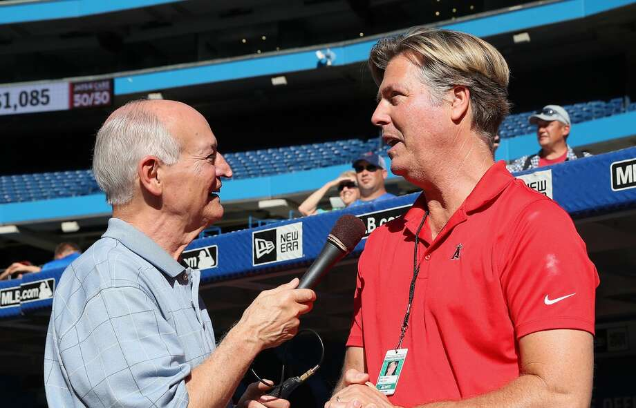 TORONTO, ON - JULY 28: Toronto Blue Jays radio broadcaster Jerry Howarth interviews former pitcher and current radio color commentator Mark Langston of the Los Angeles Angels of Anaheim during batting practice before the start of MLB game action against the Toronto Blue Jays at Rogers Centre on July 28, 2017 in Toronto, Canada. (Photo by Tom Szczerbowski/Getty Images) Photo: Tom Szczerbowski/Getty Images