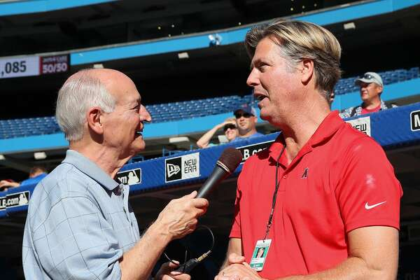 TORONTO, ON - JULY 28: Toronto Blue Jays radio broadcaster Jerry Howarth interviews former pitcher and current radio color commentator Mark Langston of the Los Angeles Angels of Anaheim during batting practice before the start of MLB game action against the Toronto Blue Jays at Rogers Centre on July 28, 2017 in Toronto, Canada. (Photo by Tom Szczerbowski/Getty Images)