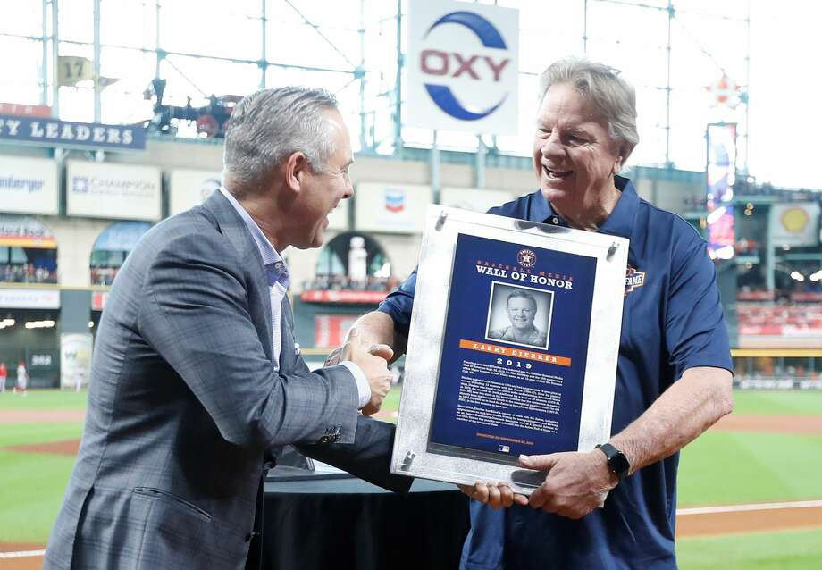 Former Houston Astros pitcher Larry Dierker shakes hands with Reid Ryan after being inducted into the Media Wall of Honor before an MLB baseball game at Minute Maid Park, Sunday, Sept. 22, 2019, in Houston. Photo: Karen Warren/Staff Photographer
