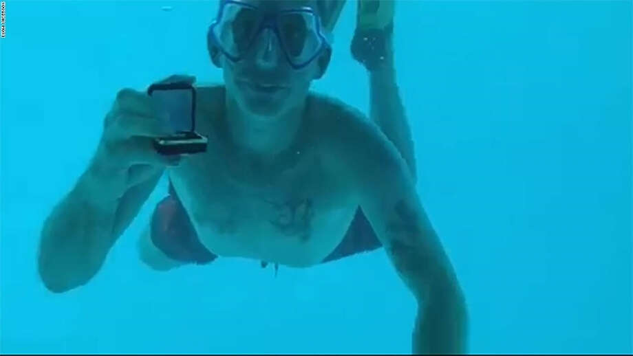 He went underwater to propose to his girlfriend, but he didn't live to hear her say 'yes'
