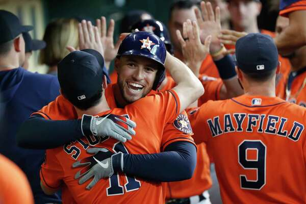 Houston Astros George Springer (4) celebrates his second home run of the game with Garrett Stubbs (11) in the second inning of an MLB baseball game at Minute Maid Park, Sunday, Sept. 22, 2019, in Houston.