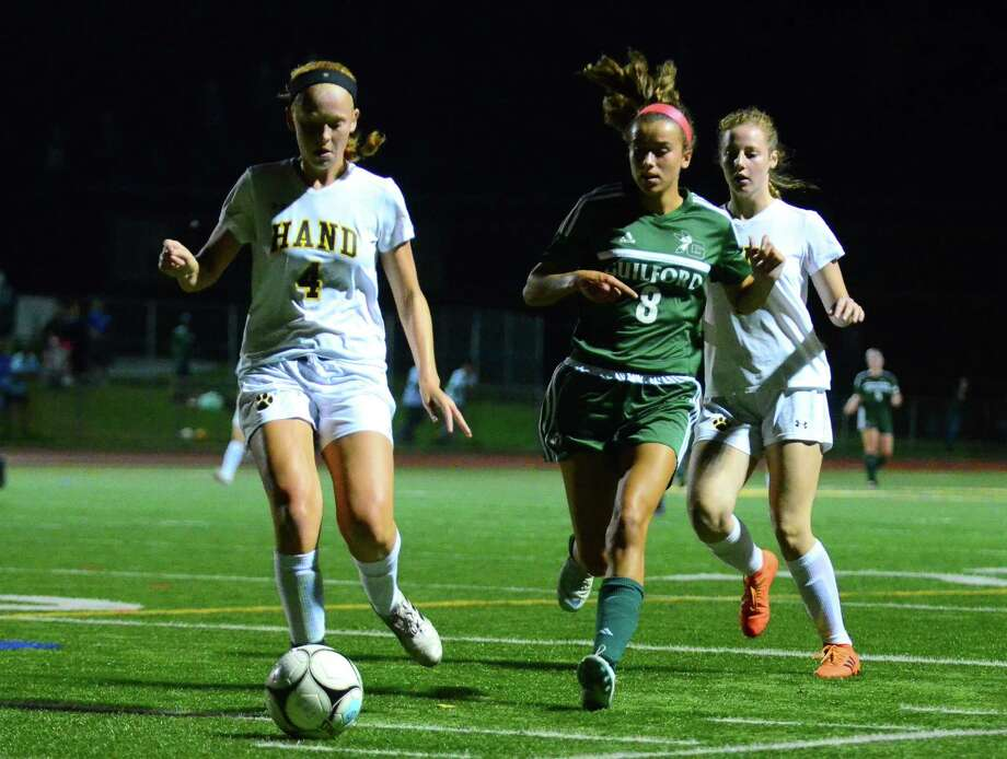 Guilford's Lily Riccio, right, seen here against Hand last season, scored all three goals in the Indians' 3-0 win over Lauralton Hall last week. Photo: Christian Abraham / Hearst Connecticut Media / Connecticut Post