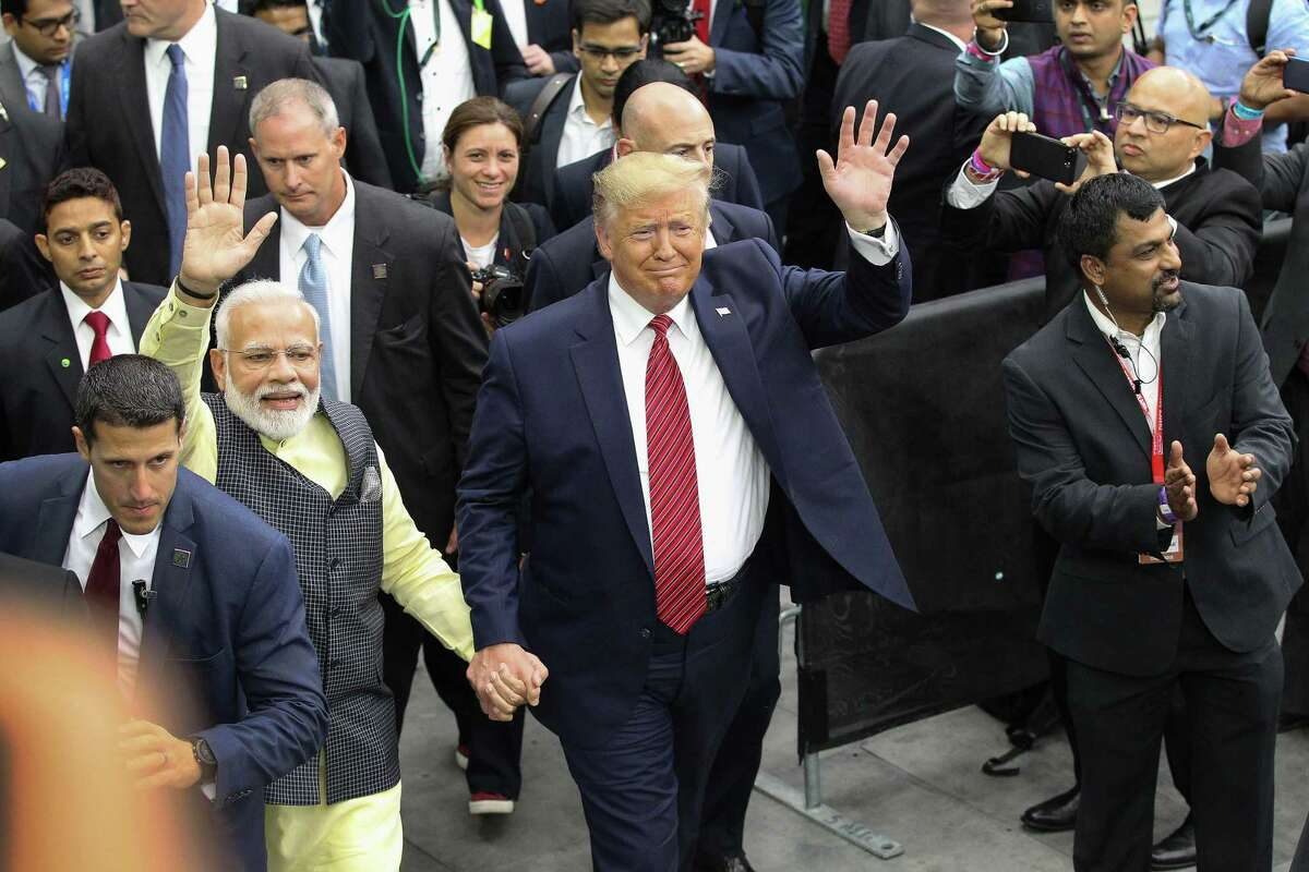 India's prime minister, Narendra Modi and President Donald Trump walk hand and hand around NRG Stadium after the Howdy Modi event Sunday, Sept. 22, 2019, in Houston.