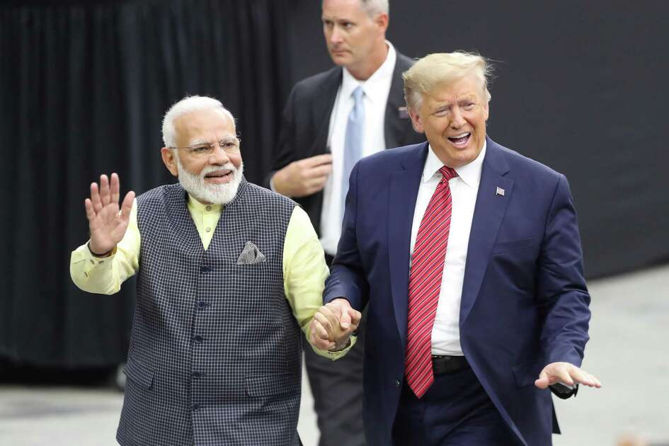 India's prime minister, Navendra Modi and President Donald Trump walk hand and hand around NRG Stadium after the Howdy Modi event Sunday, Sept. 22, 2019, in Houston.
