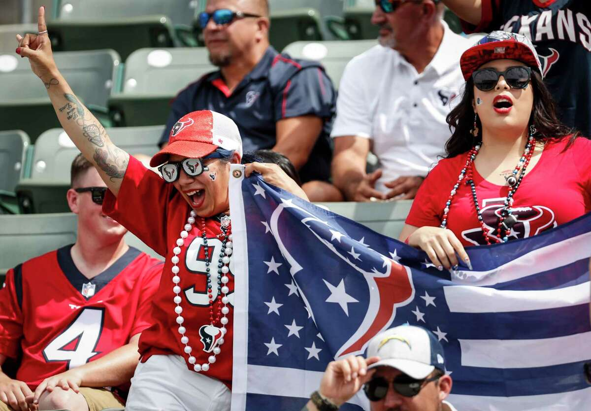 Houston Texans fans cheer before an NFL football game against the Los Angeles Chargers at Dignity Health Sports Park on Sunday, Sept. 22, 2019, in Carson, Calif.